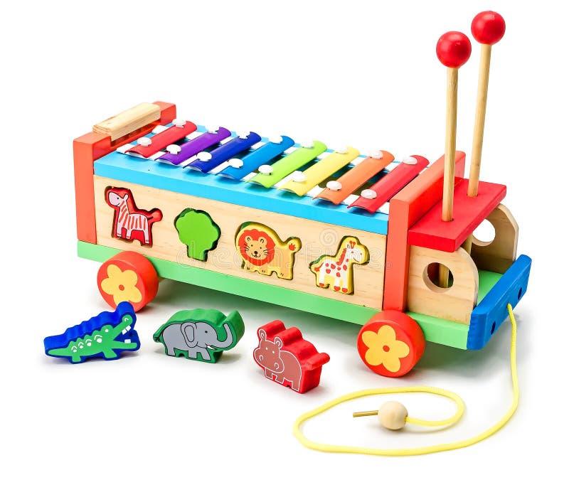Färgrik bil- musikal för metallophone eller för xylofon och framkallande leksak Utveckling av fin motorexpertis av händer och arkivbild