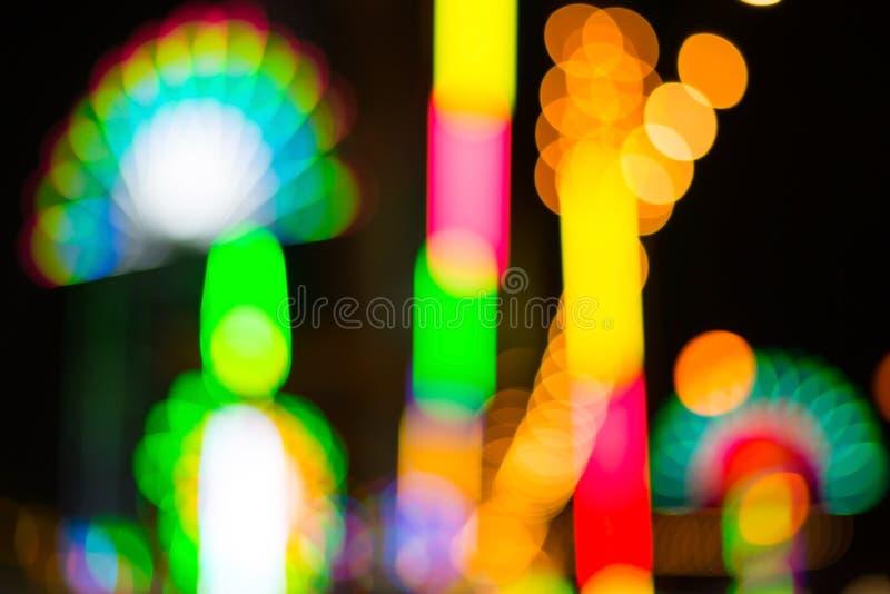 Färgrik defocused färg tänder bokehbakgrund, Chrismas ljus fotografering för bildbyråer