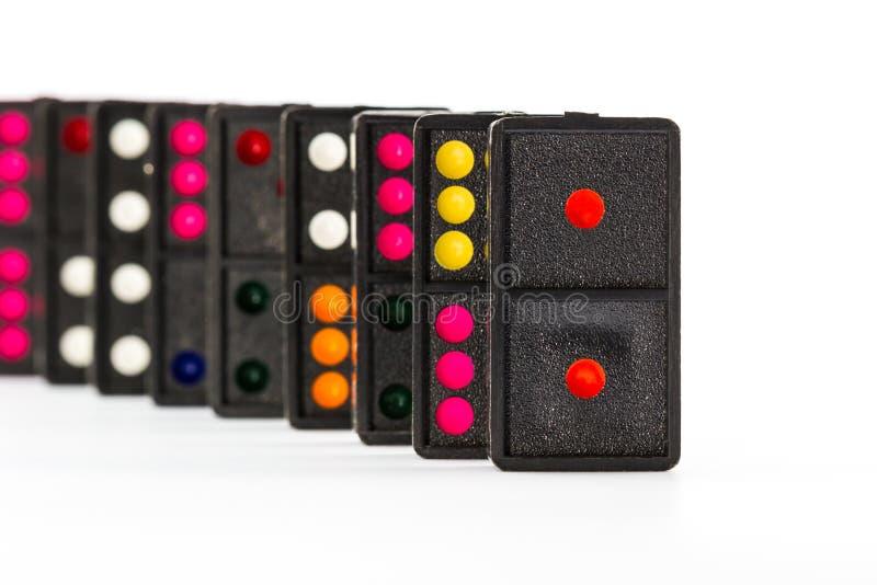 Färgrik dominobricka. arkivfoto