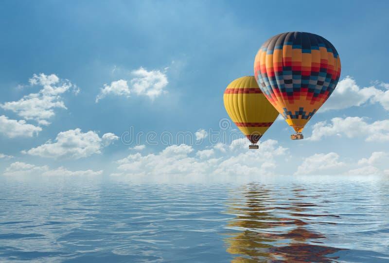 Färgrik fluga för ballong för varm luft över det blåa havet royaltyfri foto