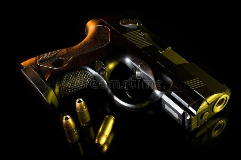 färgrik handeldvapen royaltyfria bilder