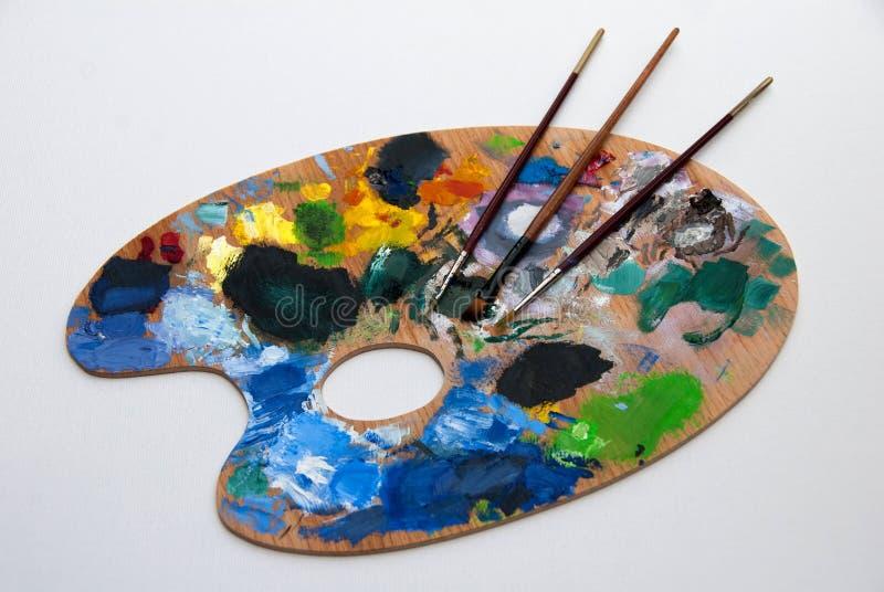 Färgrik konstpalett arkivbild