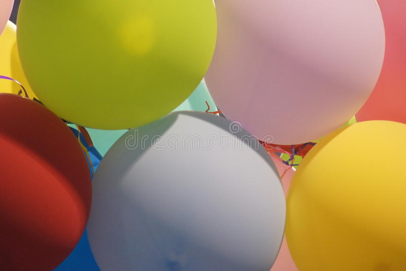 Färgrik lycklig ballongfröjd arkivfoto