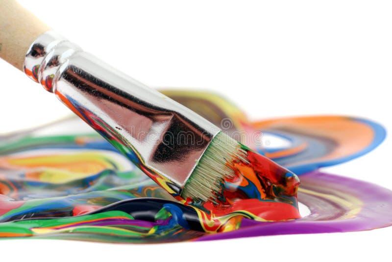 färgrik målarfärg för borste arkivfoto