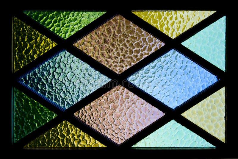 Färgrik mönstrad fönsterbakgrund royaltyfria foton