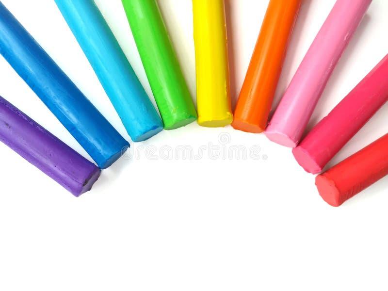 Färgrik pinneplasticinelera, härlig kurva, mångfärgad rulldeg royaltyfri fotografi