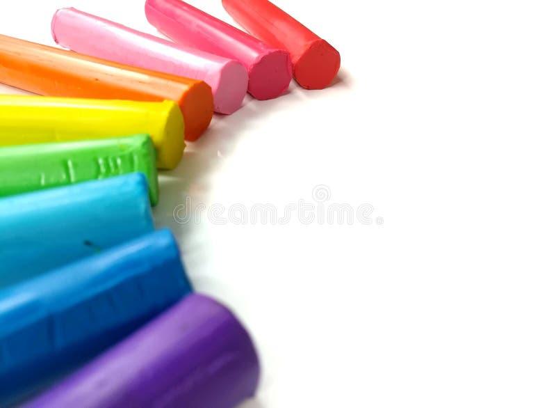 Färgrik pinneplasticinelera, härlig kurva, mångfärgad rulldeg, whid arkivfoto