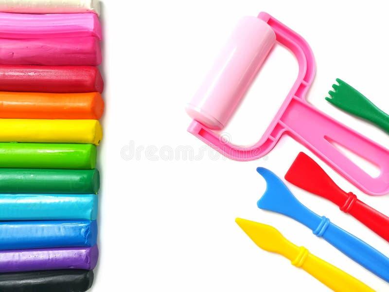 Färgrik pinneplasticinelera, variation som spelar utrustning, mångfärgad deg royaltyfria foton