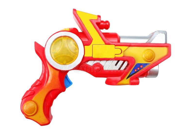 Färgrik plast- pistol som isoleras på vit bakgrund royaltyfria bilder