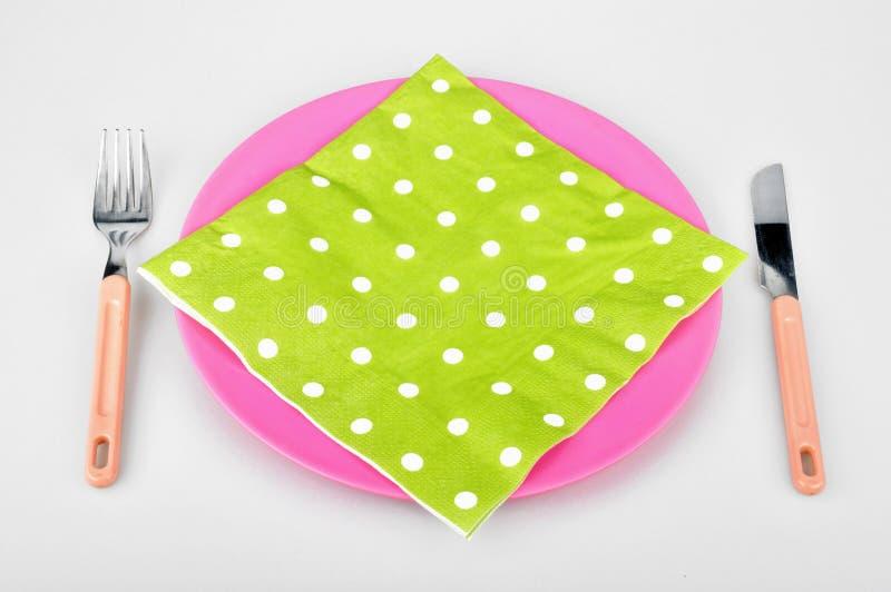 Färgrik platta och servett arkivbild