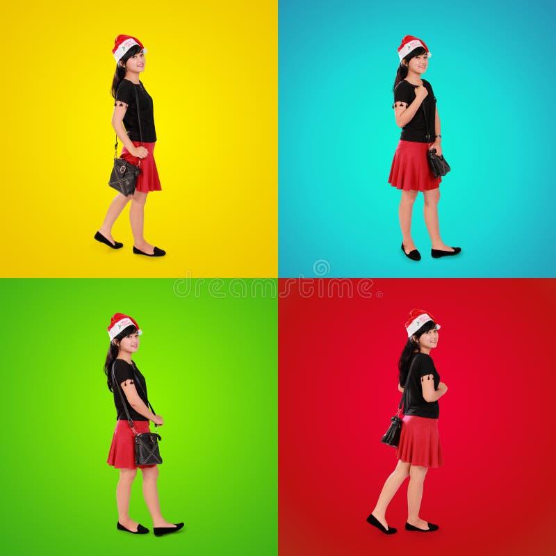 Färgrik sammansättning av den stilfulla Xmas-flickan arkivbilder