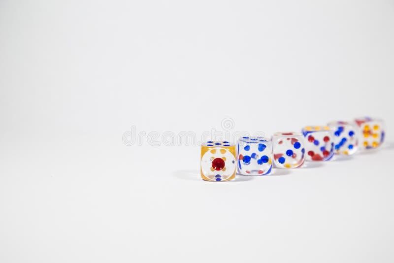 Färgrik sex tärning som isoleras på vit bakgrund royaltyfri bild