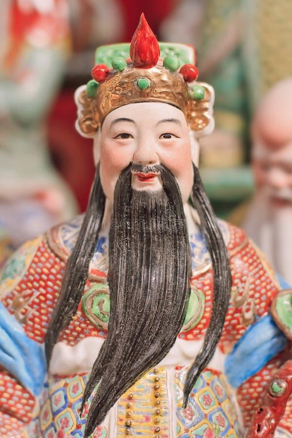 Färgrik skulptur av en forntida kinesisk adelsman på den Panjiayuan loppmarknaden, Peking, Kina royaltyfri foto