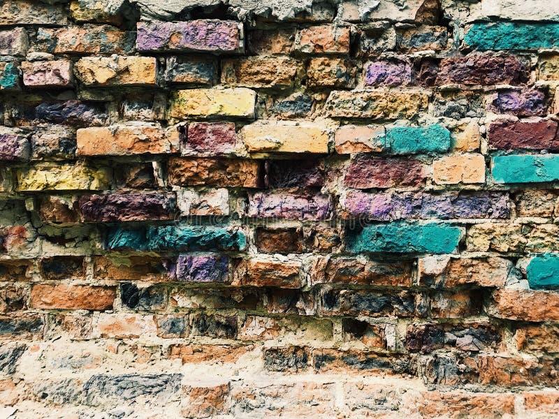 Färgrik tappningtegelstenbakgrund royaltyfri foto