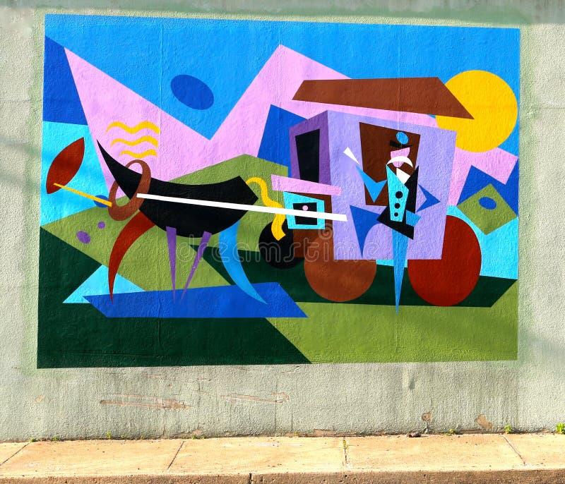 Färgrik väggmålning av en etapplagledare och en chaufför On James Road i Memphis, Tennessee royaltyfria bilder