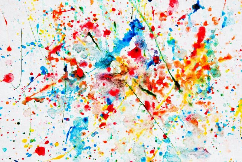 Färgrik vattenfärgfärgstänk på vitbok arkivbild