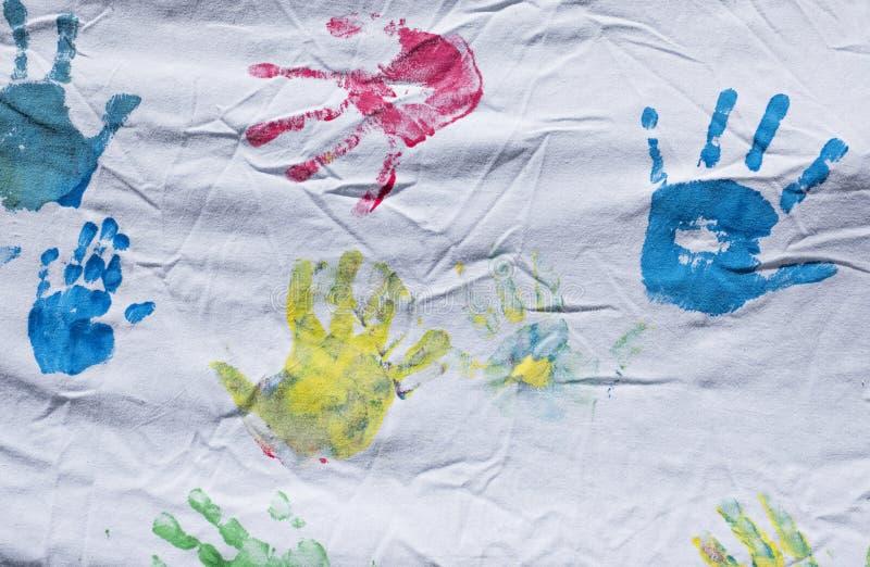 Färgrika barnhandtryck arkivfoto