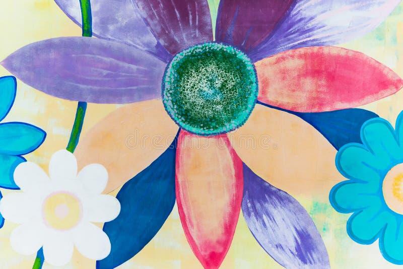 Färgrika blommor som målas på väggen arkivfoto