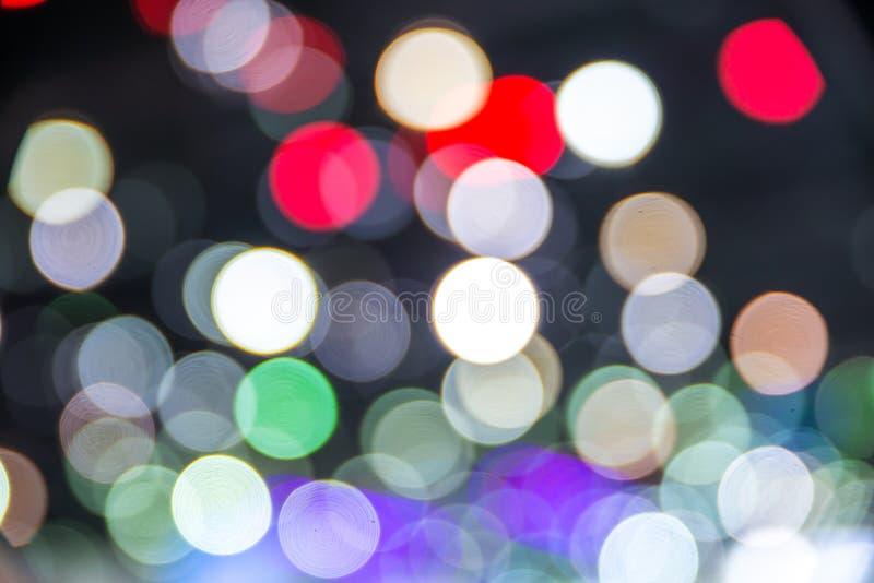 Färgrika cirklar av ljusabstrakt begreppbakgrund royaltyfria bilder