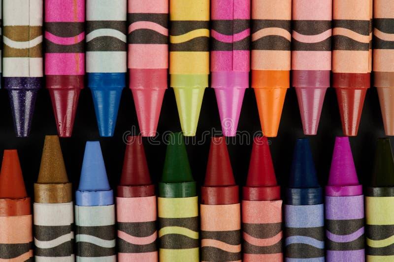 Färgrika färgpennor stänger sig upp sikt fotografering för bildbyråer