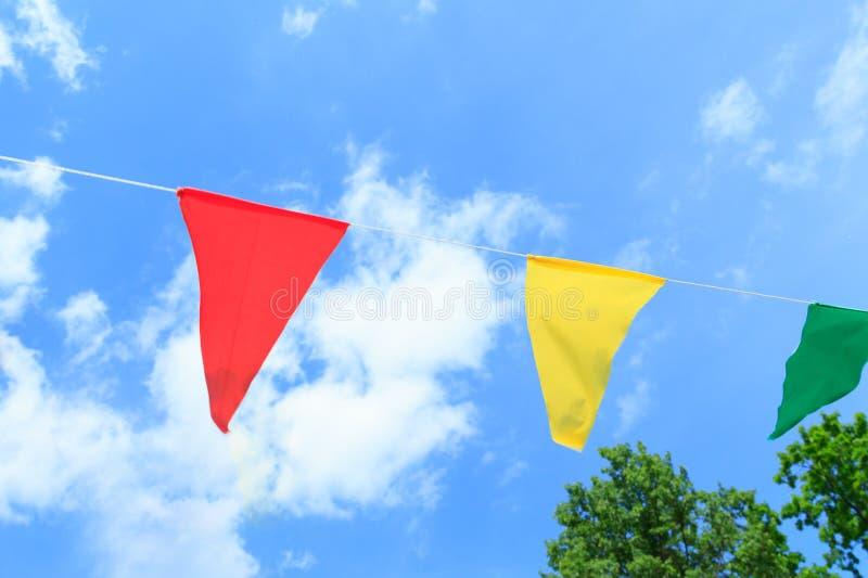 Färgrika festliga flaggor royaltyfri fotografi