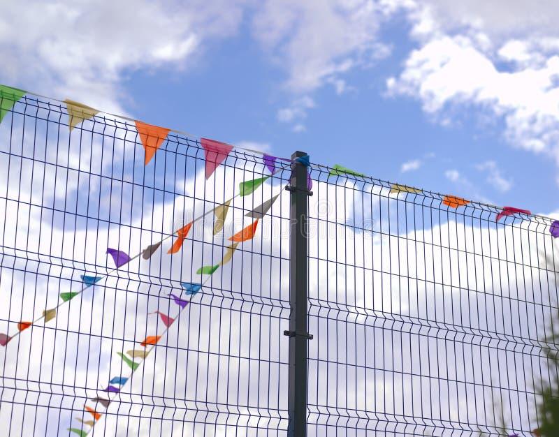 Färgrika festliga flaggor arkivbilder
