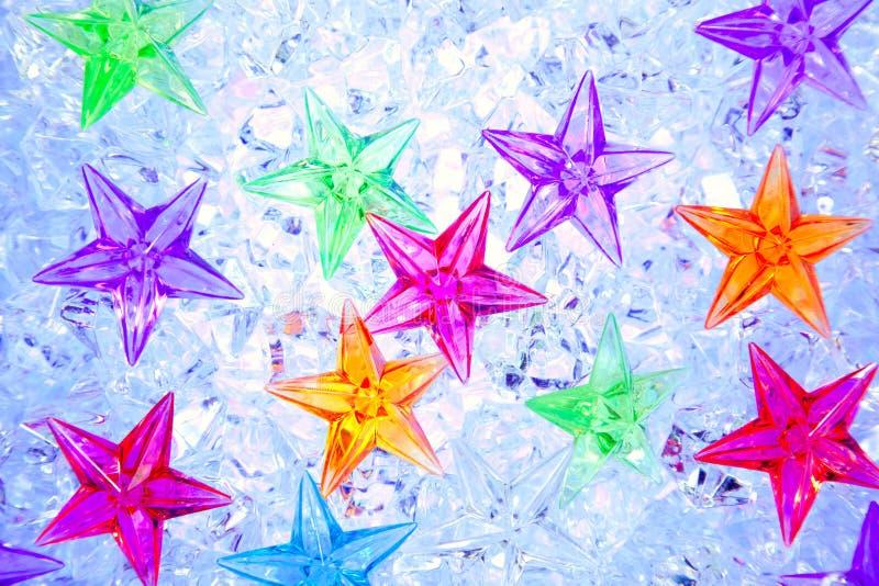 färgrika isstjärnor för blå jul arkivbilder