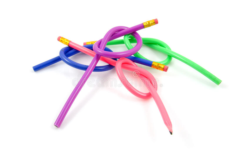 färgrika knöt blyertspennor royaltyfri fotografi