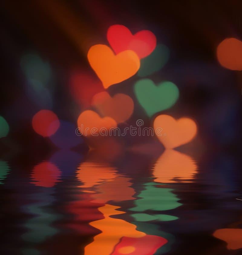 Färgrika ljus för suddig bokeh med reflexion i vatten arkivbild