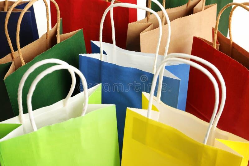 Färgrika pappers- shoppa påsar som bakgrund royaltyfria bilder
