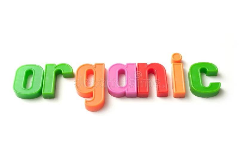 färgrika plast- bokstäver på organisk vit bakgrund - royaltyfri fotografi