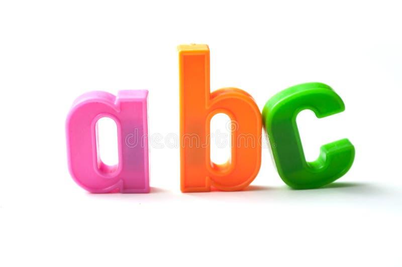 färgrika plast- bokstäver på vit bakgrund - abc royaltyfri foto
