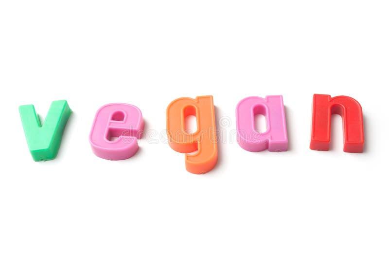 färgrika plast- bokstäver på vit bakgrund - strikt vegetarian fotografering för bildbyråer