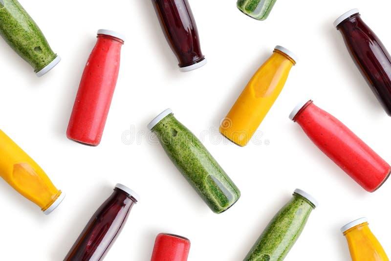 Färgrika smoothies i glasflaskor royaltyfria foton