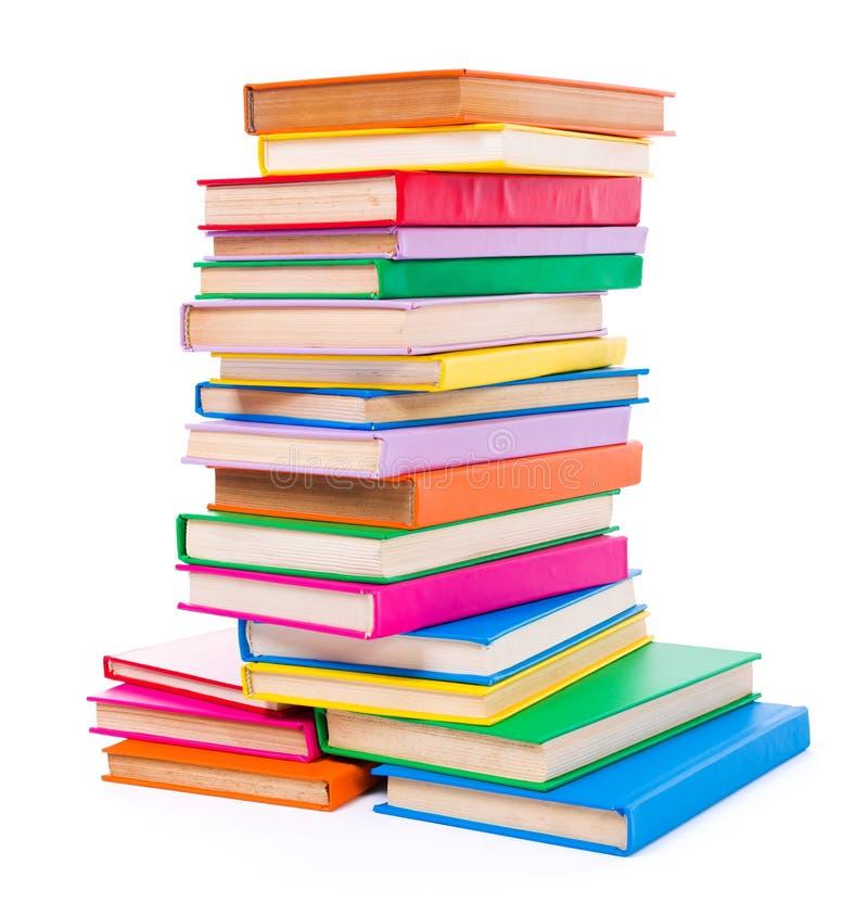 Färgrika staplade böcker royaltyfria bilder