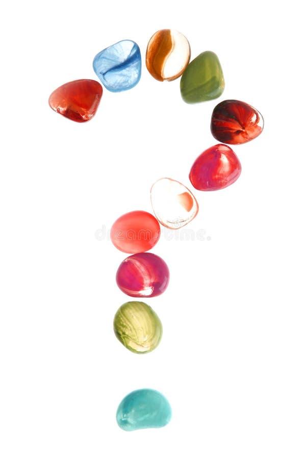 färgrika stenar för fläckfrågeform arkivfoton