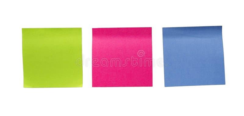 Färgrika tomma klibbiga anmärkningar Minneslistapinne- eller stolpeanmärkning arkivbild