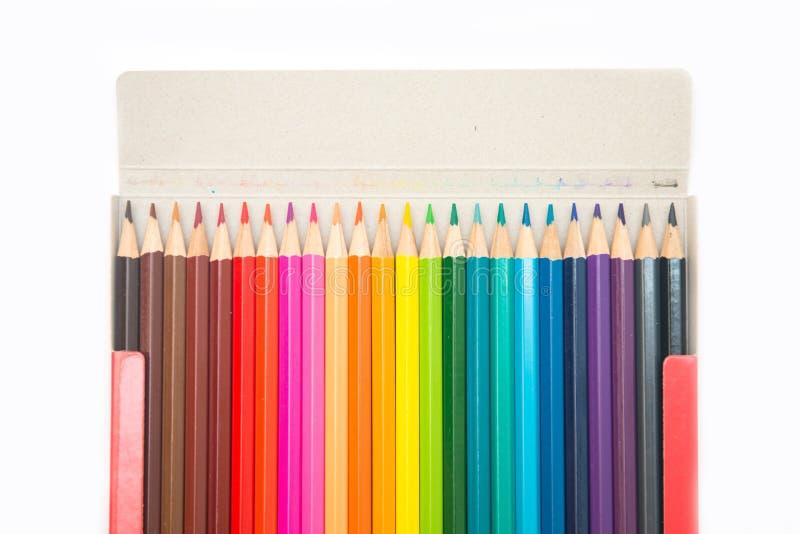 Färgrikt av färgpennaträ i pappers- ask royaltyfria bilder