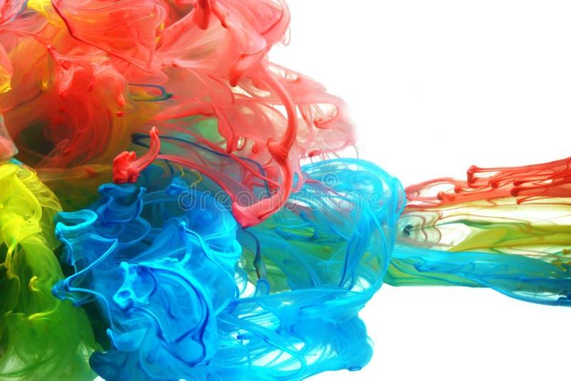 Färgrikt färgpulver bevattnar in arkivfoto