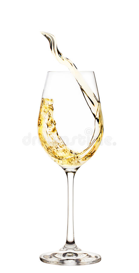 Färgstänk av vitt vin i exponeringsglas royaltyfria foton