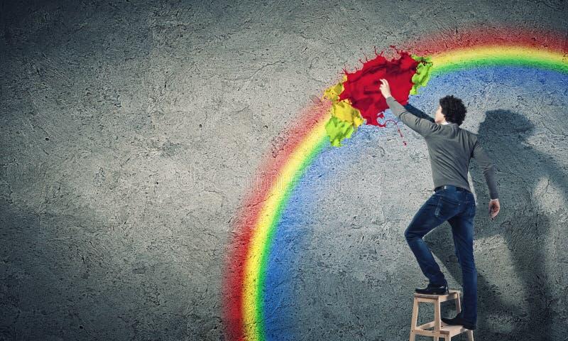 Färgstänk för ung man och färg arkivfoton