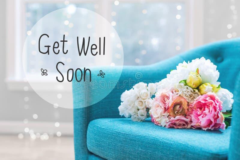 Få det väl meddelandet med blommabuketter med stol arkivbild