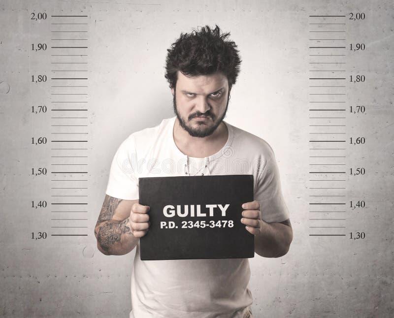 Fångad gangster i arrest arkivbilder