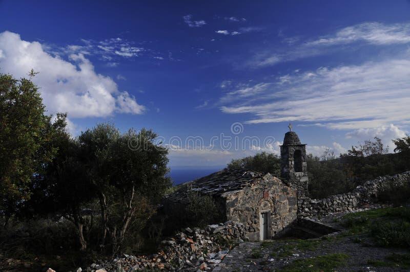 Fé, mar, rocha, Olive Trees e céus fotografia de stock