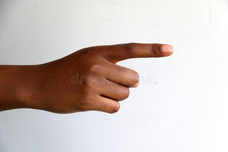 F?mea, apontar indiano da m?o do africano negro imagem de stock