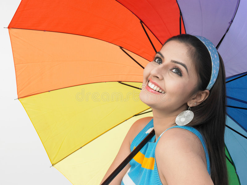 Fêmea asiática com um guarda-chuva fotos de stock royalty free