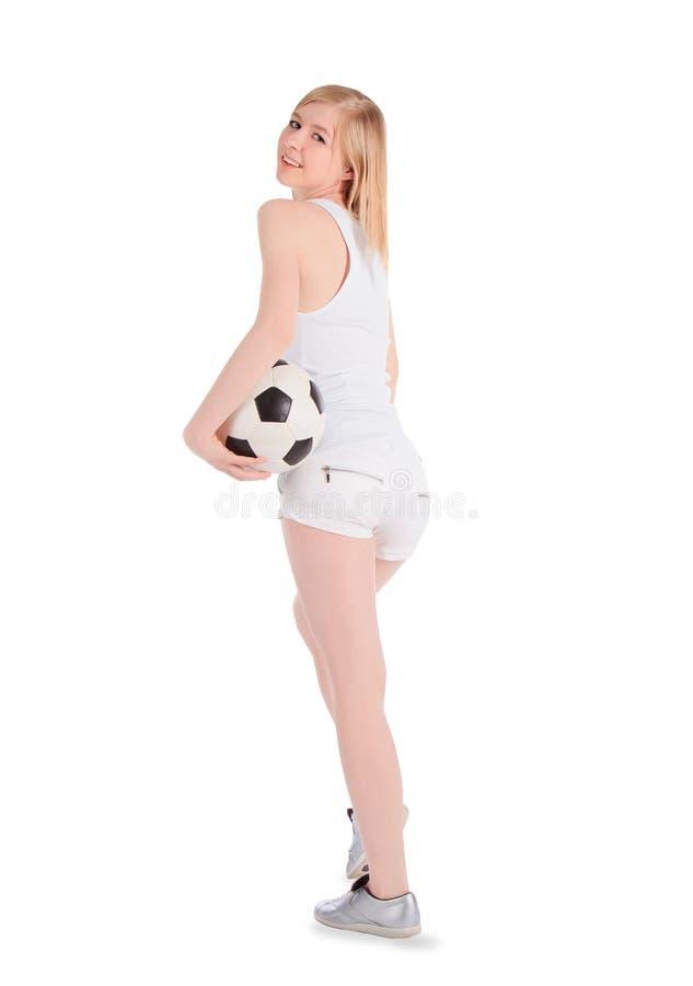 Fêmea caucasiano com a bola de futebol no fundo branco imagens de stock