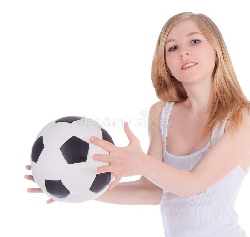 Fêmea caucasiano com a bola de futebol no fundo branco fotos de stock royalty free