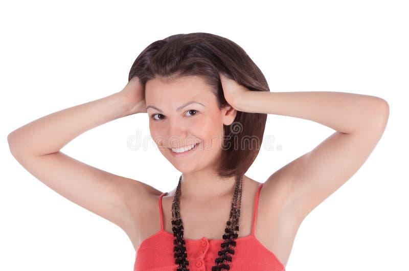Fêmea de sorriso do latino no levantamento vermelho do vestido fotos de stock royalty free