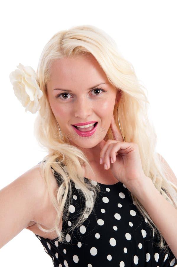 Fêmea feliz bonita no vestido do ponto do polker fotografia de stock royalty free